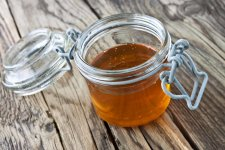 a-honey-and-jar-against-wooden-background.jpg